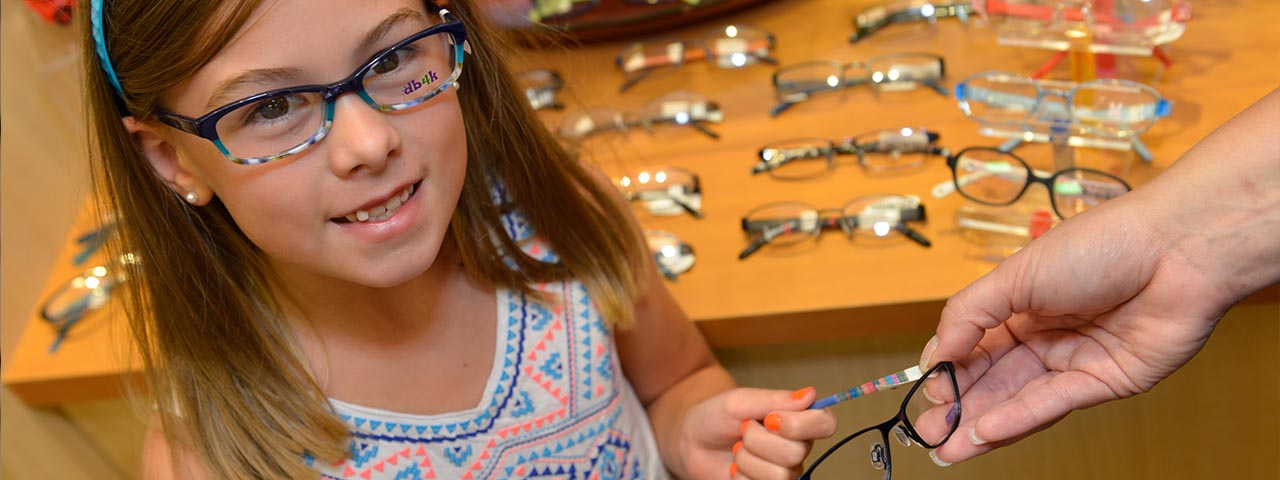 Trying on glasses - Lakeville Family Eye Care - Eye Doctor